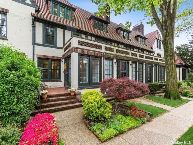 4 BR,  3.00 BTH Tudor style home in Forest Hills