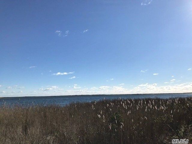 Lot <b>Size:</b> 0.92 Land style home in Mastic Beach