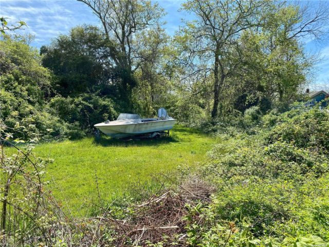 Lot <b>Size:</b> 60 X 150 Land style home in Patchogue
