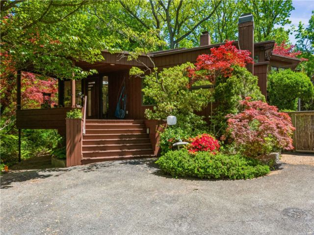 4 BR,  4.00 BTH Mid century mod style home in Sands Point