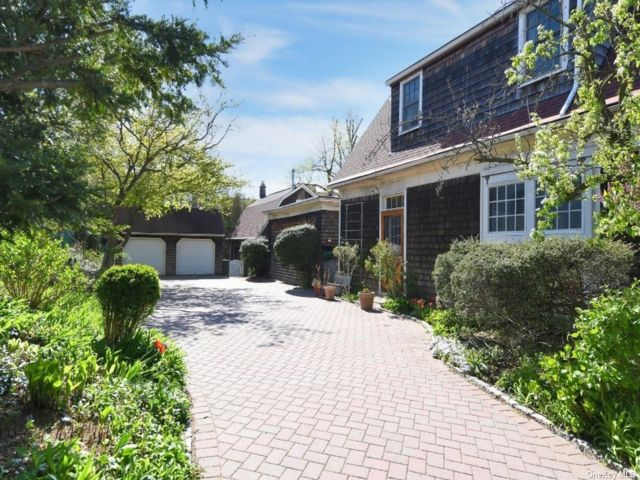 4 BR,  3.00 BTH Carriage house style home in Douglaston