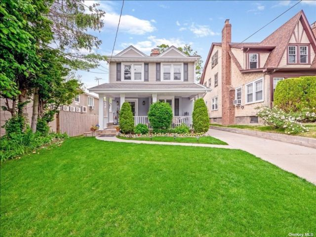 4 BR,  3.00 BTH Colonial style home in Little Neck