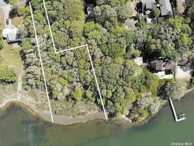 Lot <b>Size:</b> .93 Land style home in Mastic Beach