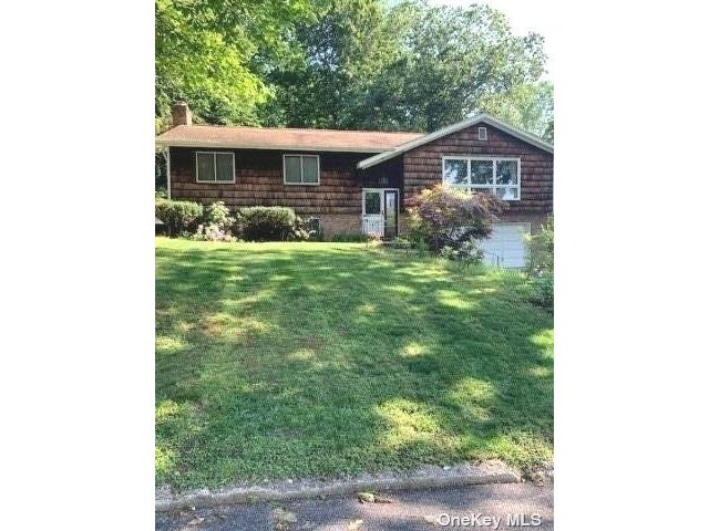 3 BR,  3.00 BTH Hi ranch style home in Glen Cove