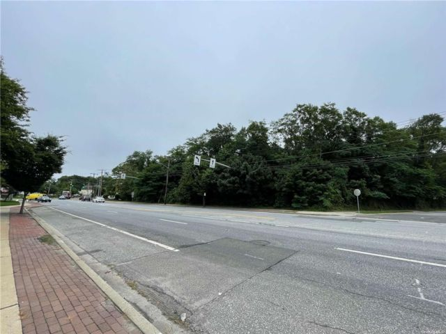 Lot <b>Size:</b> 1.1 acres Land style home in Massapequa
