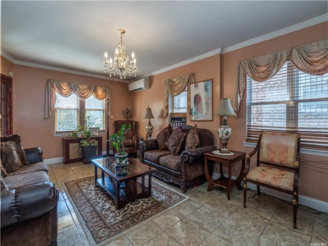 4 BR,  3.00 BTH Colonial style home in Maspeth