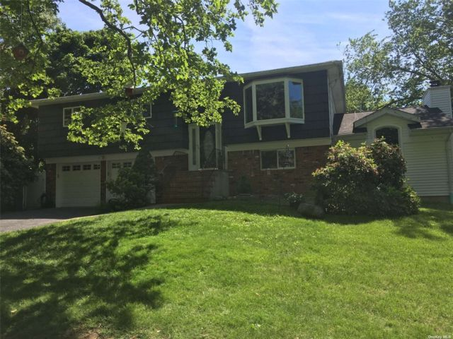 4 BR,  3.00 BTH Hi ranch style home in Huntington Station