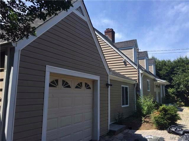 4 BR,  3.50 BTH Colonial style home in Huntington Station