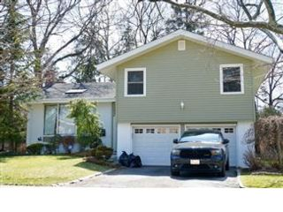 4 BR,  2.50 BTH  Split style home in Jericho