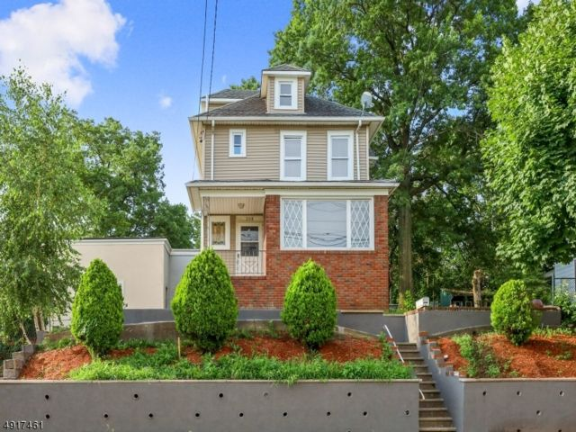 3 BR,  1.50 BTH  Colonial style home in Garfield