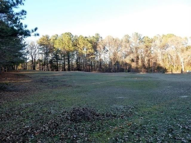 Lot <b>Size:</b> 25.19  Land style home in Lawrenceville