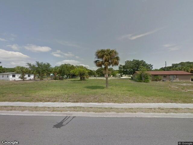 Lot <b>Size:</b> 0.12  Land style home in Titusville