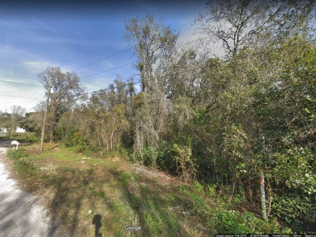 Lot <b>Size:</b> 0.18 Land style home in New Port Richey