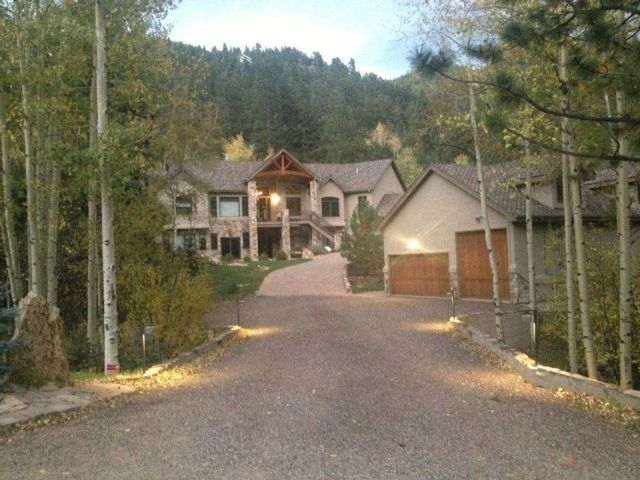 4 BR,  3.50 BTH Raised ranch style home in Evergreen