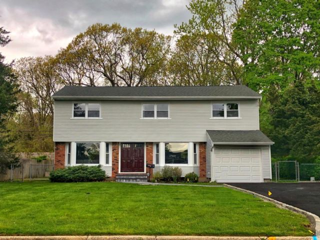4 BR,  2.50 BTH  style home in Commack