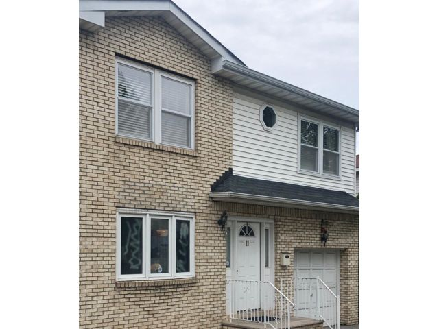 4 BR,  3.50 BTH Colonial style home in Kearny