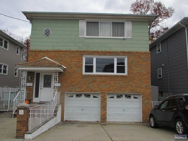 4 BR,  2.00 BTH  2 family style home in Kearny