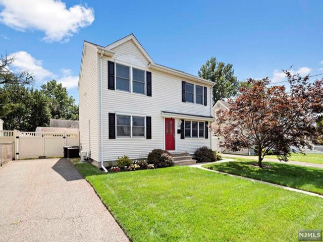 3 BR,  2.00 BTH Colonial style home in Elmwood Park