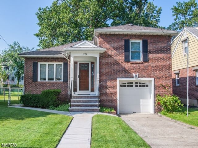 4 BR,  2.50 BTH Split level style home in Nutley