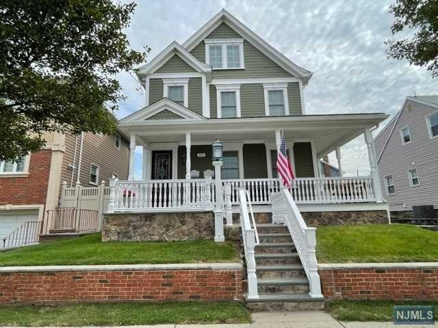 3 BR,  2.00 BTH 2 family style home in Carlstadt