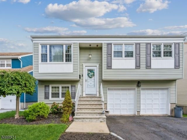 4 BR,  3.00 BTH Bi-level style home in Nutley