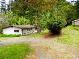 3 BR,  2.50 BTH Double wide mfh style home in Gold Beach